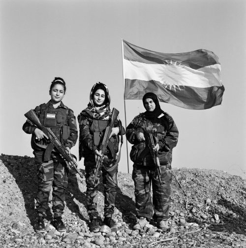 Ahou & Daughters in Front of the Kurdish Flag