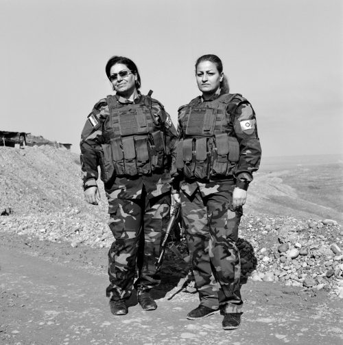 Katha, 45 years old, and Maasthura, 30 years old: Peshmerga Soldiers under Hussein Yazdanpana's command in the Kurdistan Freedom Party (PAK), on the Frontline, Northwest Kirkuk, Iraqi Kurdistan, November 2015.