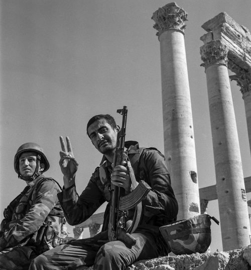 Victorious Syrian Soldiers making the Sign of Peace in the Antique City of Palmyra.