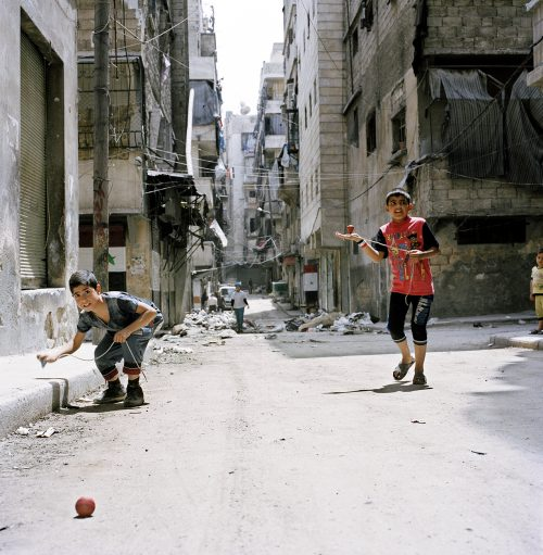 Boys playing with spinning tops, Aleppo 2017