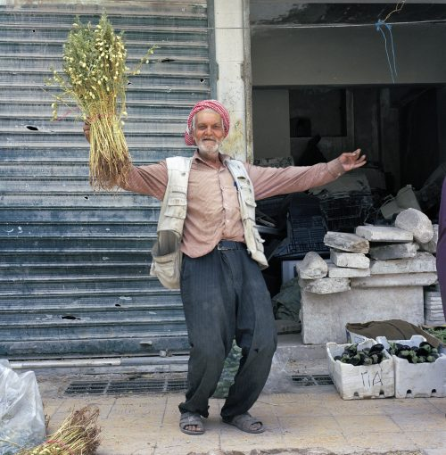 Abou Jumar danses with a bunch of chick-peas, Aleppo 2017